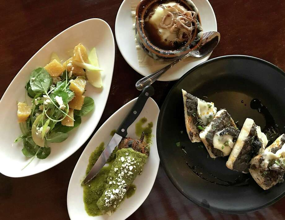 Roasted beet salad, French onion soup, escargot toast and a lamb-stuffed chile relleno at Julia's Bistro & Bar Photo: Paul Stephen / Staff