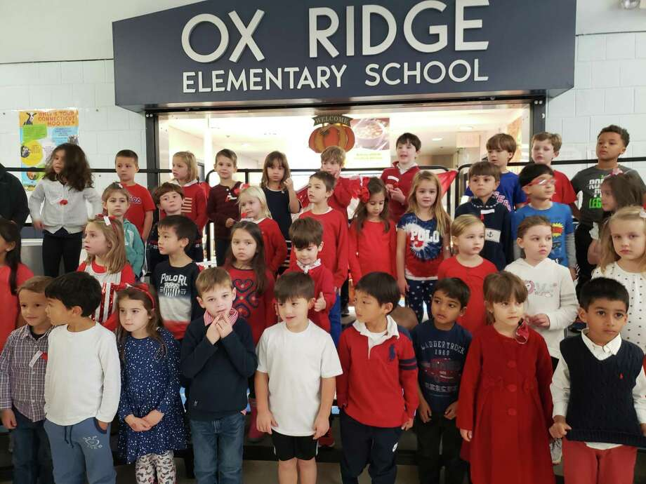 Children from Ox Ridge Elementary School sang patriotic songs to veterans on Thursday at the Veterans Day Celebration. Photo: Sandra Diamond Fox / Hearst Connecticut Media / Connecticut Post