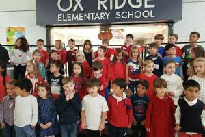Children from Ox Ridge Elementary School sang patriotic songs to veterans on Thursday at the Veterans Day Celebration.