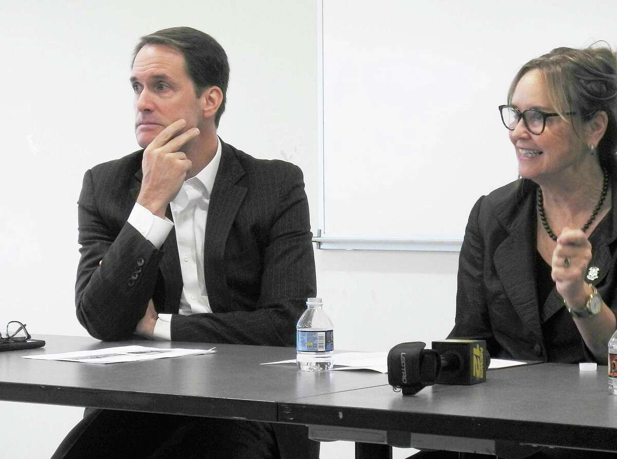 Congressman Jim Himes (D-4th) and Secretary of the State Denise Merrill listen as a member of the audience asks a question during a forum on election security at the Comstock Community Center on Nov. 7.