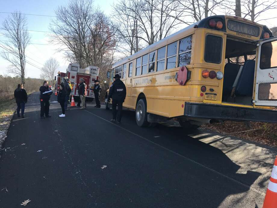 A bus driver and four children needed medical care after a school bus slid off a rural road and hit a tree in Taghkanic. Photo: Columbia County Sheriff's Office