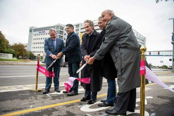 "It was all smiles when District 8 City Councilman Manny Pelaez, Mayor Ron Nirenberg and others officially opened the ""green street"" along Floyd Curl in the Medical Center. But a reader is unimpressed with the way City Council is spending taxpayer money and considers the project a waste."