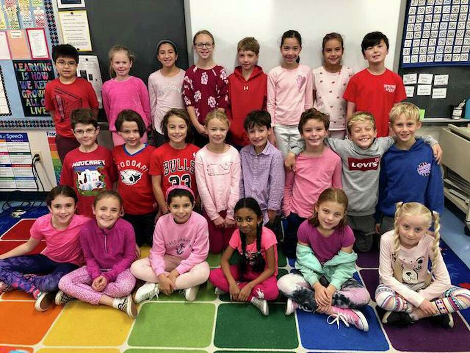 The South School staff, Mrs. Bulkley's fourth grade class and Mrs. Hollander's kindergarten class. Photo: Contributed Photo