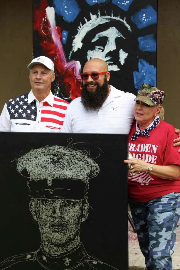 Doug Bailess (left) with artist Joe Everson (center), and his wife, Claudia Bailess (right) at this year's Braden Bailess Memorial Golf Tournament. Photo: Provided