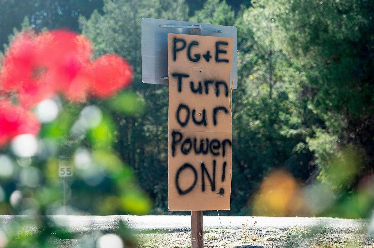 A sign calling for utility company PG&E to turn the power back on is seen on the side of the road during a statewide blackout in Calistoga, California, on October, 10, 2019 - Rolling blackouts set to affect millions of Californians began October 9, as Pacific Gas & Electric started switching off power to an unprecedented number of households in the face of hot, windy weather that raises the risk of wildfires. PG & E, which announced the deliberate outage, is working to prevent a repeat of a catastrophe last November in which faulty power lines it owned were determined to have sparked California's deadliest wildfire in modern history. (Photo by Josh Edelson / AFP) (Photo by JOSH EDELSON/AFP via Getty Images)