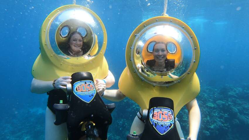Jess Kelly and a friend using BOSS underwater scooters during a cruise excursion. (Photo by Jess Kelly)