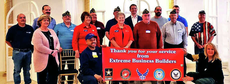 Fifteen veterans and two spouses of veterans gather for a photo after being honored at a local Extreme Business Builders' meeting on Thursday morning. Photo: Tyler Pletsch | The Intelligencer