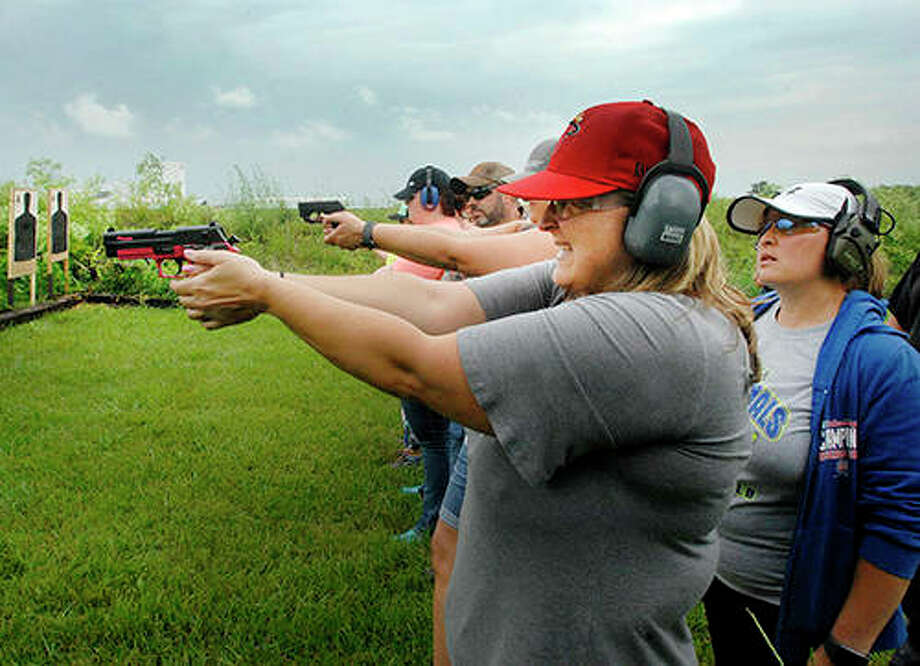 Jill Collins, a third grade teacher at DeLand-Weldon Elementary School, fires off a round during a concealed carry class for teachers Sunday, June 10, 2018, at Adventure Tactical Training in Farmer City. At its Nov. 22-24 meeting, the Illinois Association of School Boards is expected to revisit a resolution giving school districts the option to arm faculty. Photo: David Proeber | The Pantagraph Via AP