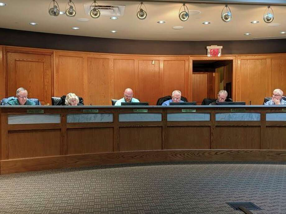 Manistee City Council had a full agenda this week. At the end of the meeting, council members and city staff said farewell to Chip Goodspeed, and welcomed a new council member. (Ashlyn Korienek/News Advocate)