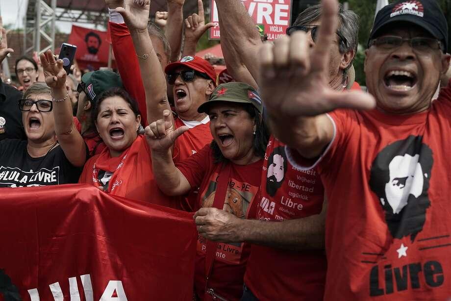Supporters wait for the release of former President Luiz Inacio Lula da Silva in Curitiba, Brazil. Photo: Leo Correa / Associated Press