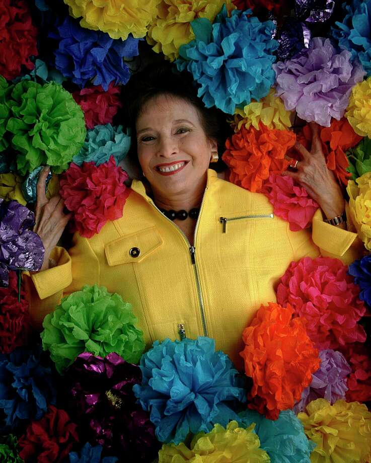 Marilyn Eldridge amid Battle of Flowers paper flowers in 2006. Photo: KEVIN GEIL /SAN ANTONIO EXPRESS-NEWS / SAN ANTONIO EXPRESS-NEWS