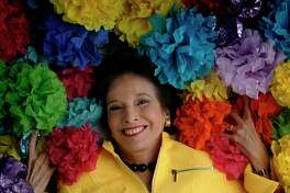 Marilyn Eldridge amid Battle of Flowers paper flowers in 2006.