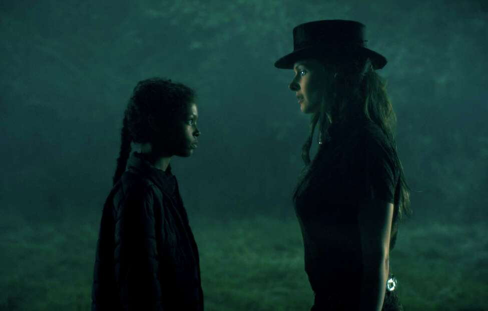 This image released by Warner Bros. Pictures shows Kyliegh Curran, left, and Rebecca Ferguson in a scene from