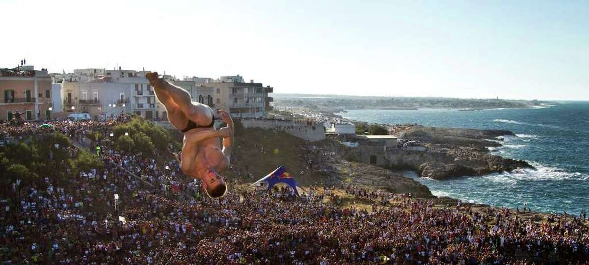 ITALY - AUGUST 8: In this handout image provided by Red Bull, Alain Kohl of Luxembourg dives from the 26.5 metre platform during round four 2010 Red Bull Cliff Diving World Series on August 8, 2010 in Polignano a Mare, Italy.