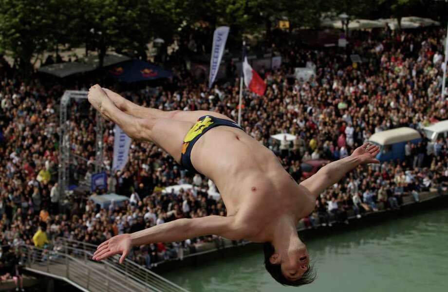 LA ROCHELLE, FRANCE - MAY 15: In this handout provided by Red Bull Photofiles, Cyrille Oumedjkane of France dives from the 27 metre platform during round one of the 2010 Red Bull Cliff Diving World Series on May 15, 2010 in La Rochelle, France. Photo: Handout, Getty Images / Red Bull via Getty Images 2010