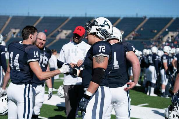 Yale lineman Dieter Eiselen (72) and receiver Reed Klubnik (14) are planning to take part in a pro day in Connecticut next month as they pursue the dream of playing in the NFL.