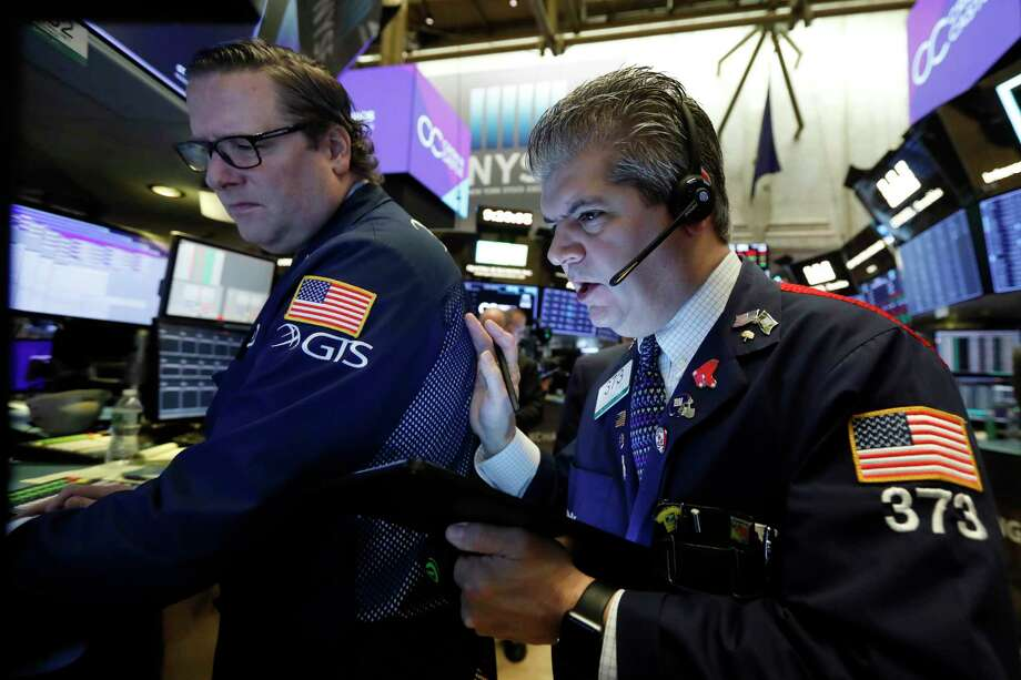 FILE - In this Oct. 29, 2019, file photo specialist Gregg Maloney, left, and trader John Panin work on the floor of the New York Stock Exchange. The U.S. stock market opens at 9:30 a.m. EST on Friday, Nov 8. (AP Photo/Richard Drew, File) Photo: Richard Drew / Copyright 2019 The Associated Press. All rights reserved
