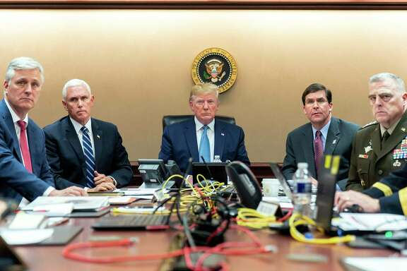 In this image released by the White House, President Donald Trump and his national security team, including Vice President Mike Pence and Defense Secretary Mark Esper, monitor developments as Special Operations forces close in on Islamic State leader Abu Bakr al-Baghdadi's compound in Syria, in the Situation Room of the White House in Washington, Oct. 26. Trump's account of Baghdadi's death differs from other accounts — a reader calls the president a liar.