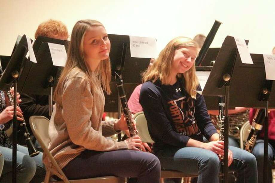 Frankfort's Katie Beeman and Benzie Central's Sierra Pallin learn from a guest conductor during the 2018 Manistee-Benzie Honors Band. (File photo)