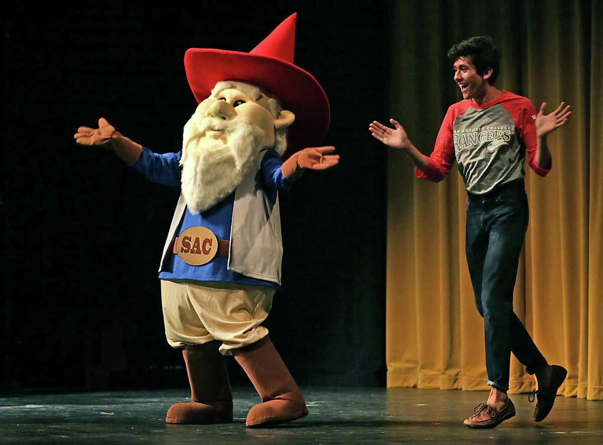 FILE PHOTO - San Antonio College's Gnome Ranger, left, does his happy dance with student Esau Perez, as he makes his first appearance in McAllister Auditorium following SAC's Convocation in which retiring President Robert Zeigler handed off to incoming President Robert Vela. Monday, Aug. 18, 2014.