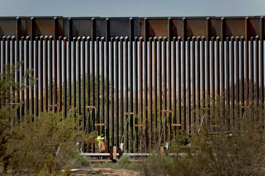 From this perspective, the 30-foot border wall in Yuma, Ariz. looks daunting, but according to news reports, smugglers have been cutting holes in the wall with a cheap cordless power saw. Photo: Matt York /Associated Press / Copyright 2019 The Associated Press. All rights reserved