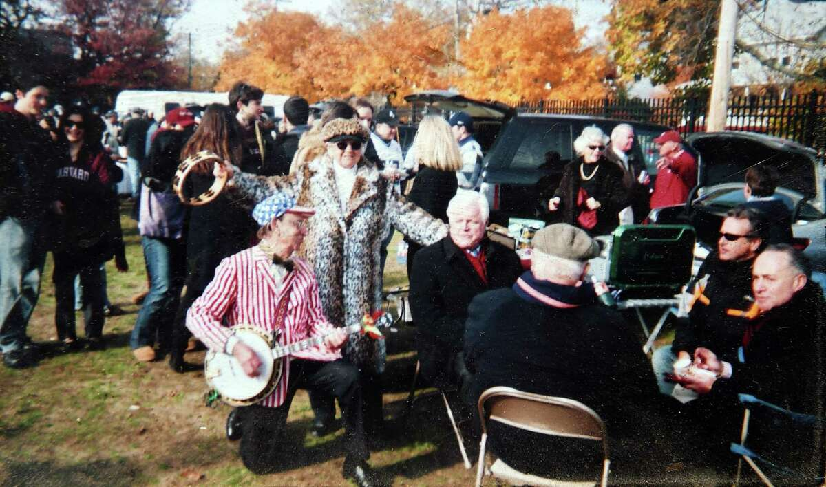 Charlie Salerno, center left, of the Clam Diggers band performs for the late Sen. Edward Kennedy, center, and Sen. Chuck Schumer, far right, as they tailgate at the Yale-Harvard football game at Yale Bowl in 2007.