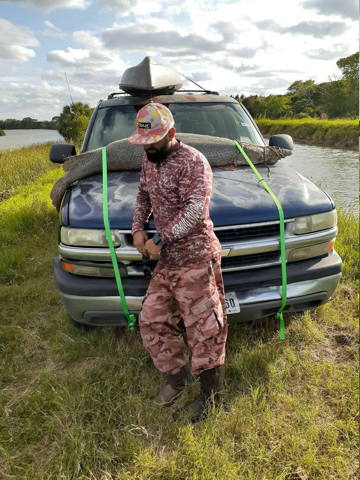 Chris Hernandez of San Benito, Texas came out victorious and reeled in a 7-foot, 200-pound alligator gar after a 40-minute fight while he was out fishing on his kayak earlier this week.