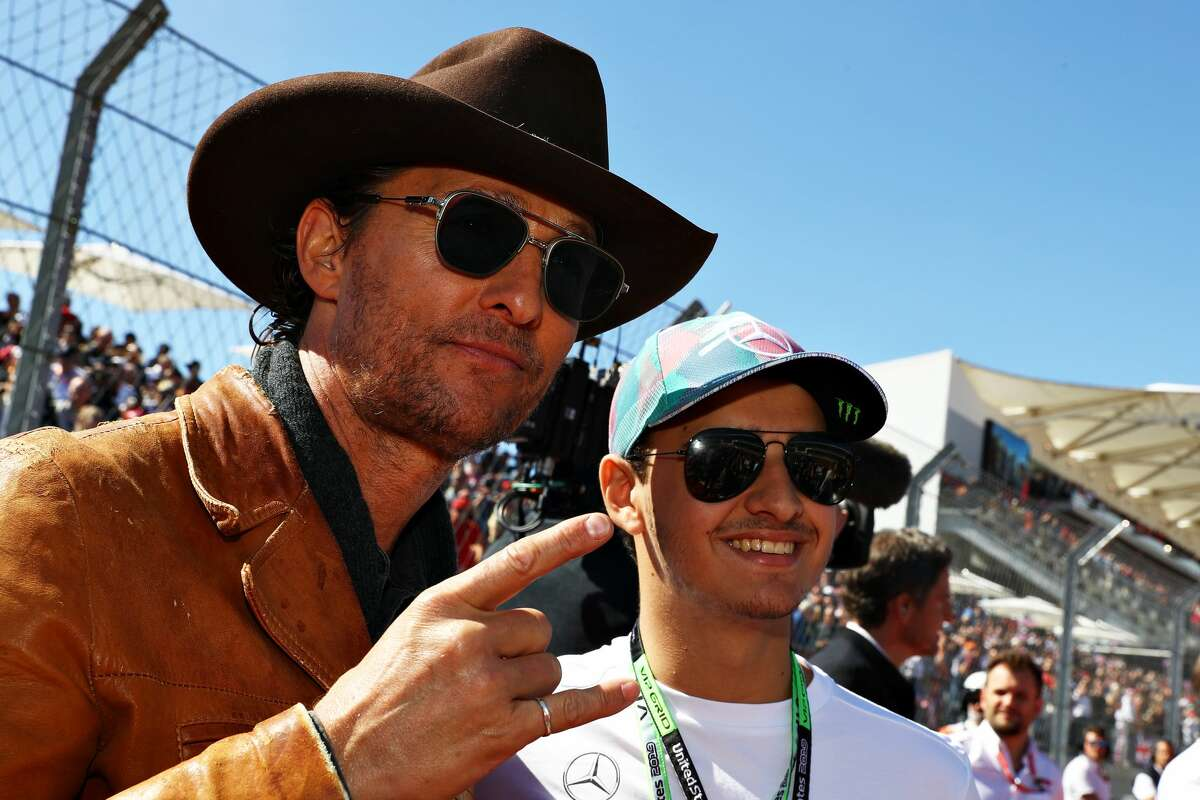 Matthew McConaughey poses for a photo on the grid before the F1 Grand Prix of USA at Circuit of The Americas on November 03, 2019 in Austin, Texas. McConaughey appeared The Balanced Voice podcast hosted by Crime Stoppers of Houston and briefly discussed a run for Texas governor. (Photo by Mark Thompson/Getty Images)