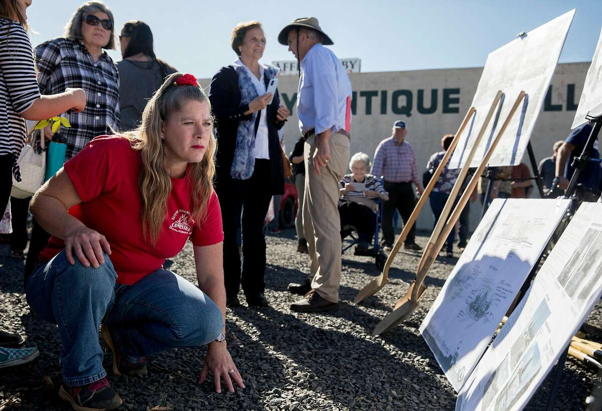 Colleen Peters of Paradise observes plans for the future Hope Plaza Memorial along Skyway during a commemoration of the one year anniversary of the devastating Camp Fire in Paradise, Calif. Friday, Nov. 8, 2019.