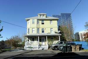 A three-story house at 21 Pulaski Street, photograph on Nov. 1, 2019, is a property that the city of Stamford is proposing to acquire, either through negotiations with the owner or through eminent domain as part of projects to ease transportation woes in the area. Pulaski Street connects Waterside and the South End, a corridor that the the city's Transportation, Traffic and Parking Department is hoping to widen.