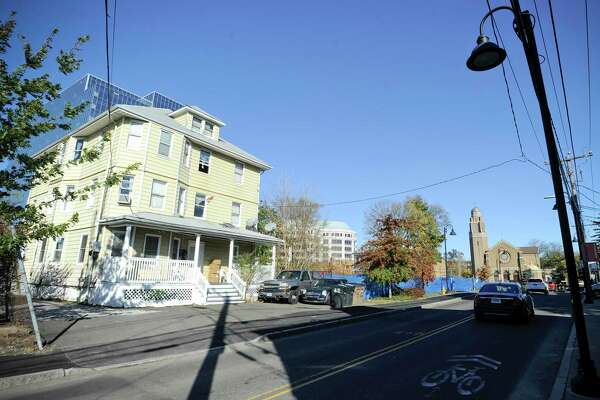 A three-story house at 21 Pulaski Street, photograph on Nov. 1, is a property that the city of Stamford is proposing to acquire, either through negotiations with the owner or through eminent domain as part of projects to ease transportation woes in the area.