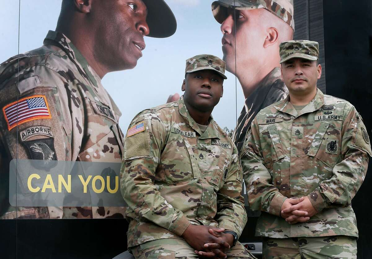 Army Staff Sgts. Isaiah Locklear (left) and Michael Marl are seen at the armed forces recruitment center in San Mateo, Calif. on Thursday, Nov. 7, 2019. They are receiving the Soldier's Medal, awarded for heroism not involving actual conflict with an enemy, at a ceremony on Friday for assisting victims of a shooting at Tanforan Mall in July.
