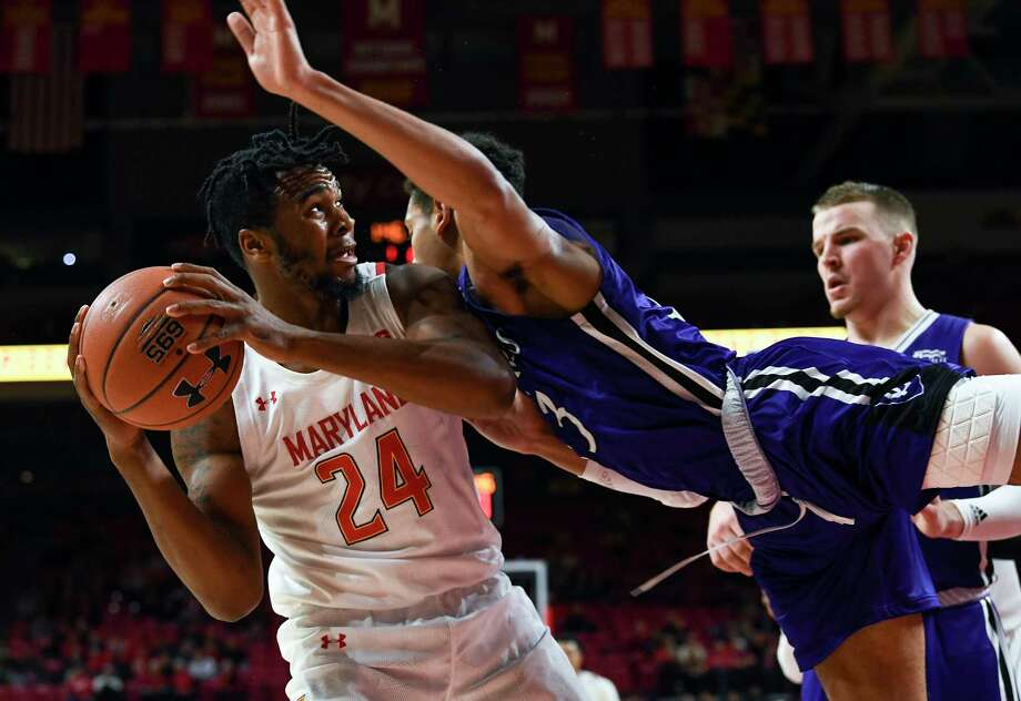 Donta Scott recorded nine points and six rebounds in his college debut, a victory over Marlon Hargis and Holy Cross. Photo: Washington Post Photo By Toni L. Sandys / The Washington Post
