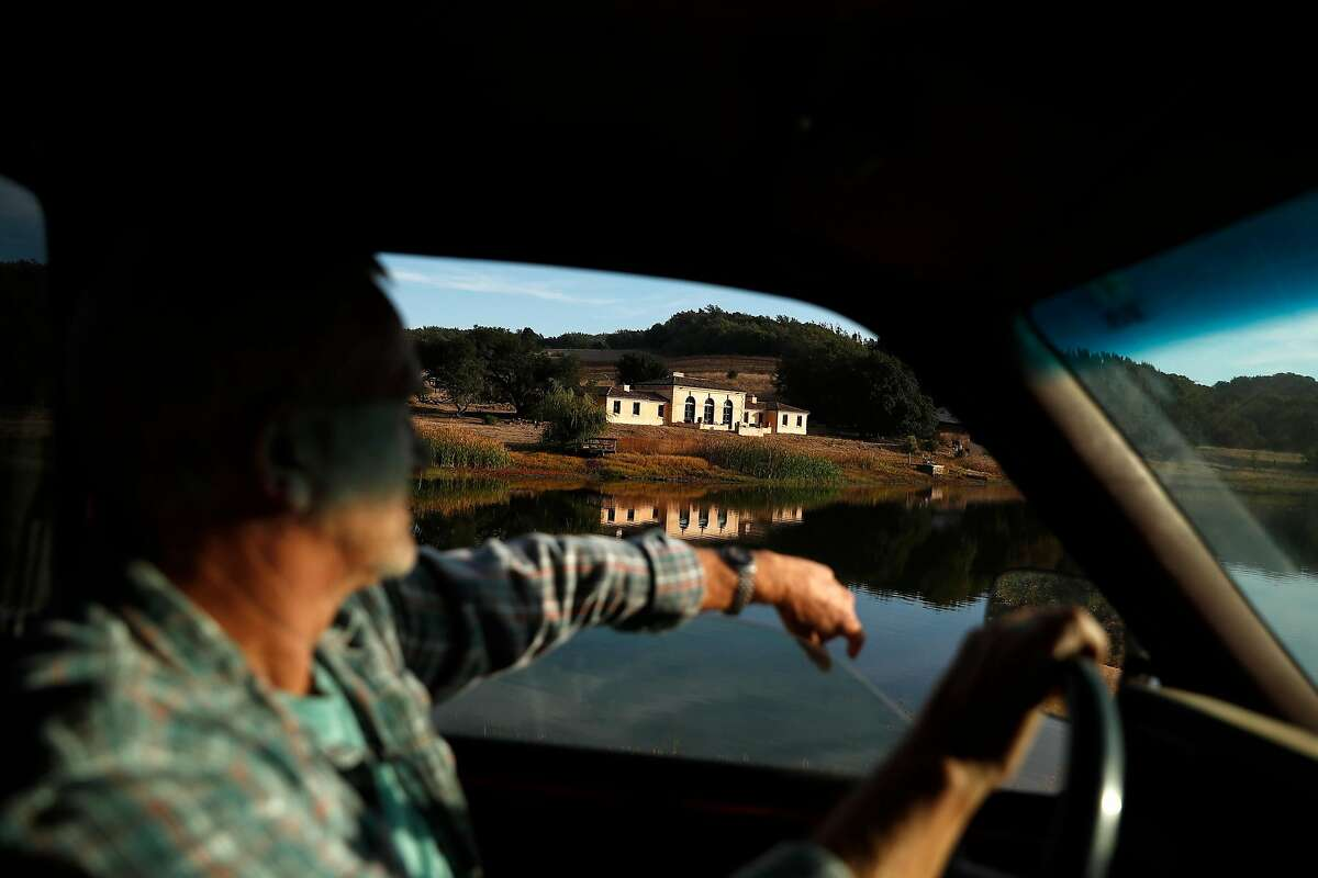 """Tom Ruge drives past Lake House on Heron Lake at Green Valley Ranch in Napa in 2019. """"There were certainly mixed emotions for everybody,"""" Ruge said of the sale."""