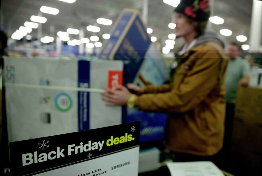 FILE - In this Nov. 22, 2018, file photo people wait in line to buy televisions as they shop during an early Black Friday sale at a Best Buy store on Thanksgiving Day in Overland Park, Kan. Black Friday is Nov. 29, 2019, but it might as well be the whole month of November. (AP Photo/Charlie Riedel, File) Photo: Charlie Riedel / Copyright 2019 The Associated Press. All rights reserved.
