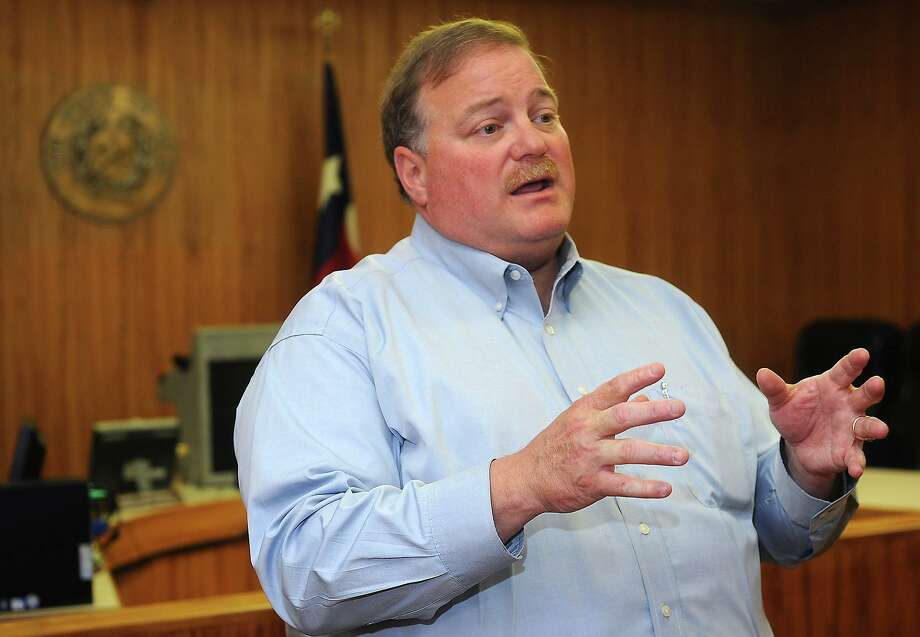 Mike Hamilton addresses media at the Kountze County Courthouse Wednesday to discuss his campaign against James White. Photo taken Wednesday, May 23, 2012 Guiseppe Barranco/The Enterprise Photo: Guiseppe Barranco, STAFF PHOTOGRAPHER / Guiseppe Barranco/The Enterprise / The Beaumont Enterprise