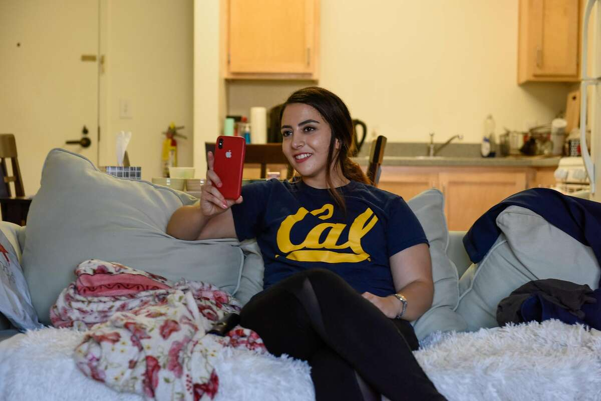 Marzieh Mirmobini, a student at UC Berkeley, has been waiting for several years for her husband, Sepehr Shakeri, to receive his marriage visa, FaceTimes with her husband on October 23, 2019 in Albany, Calif.