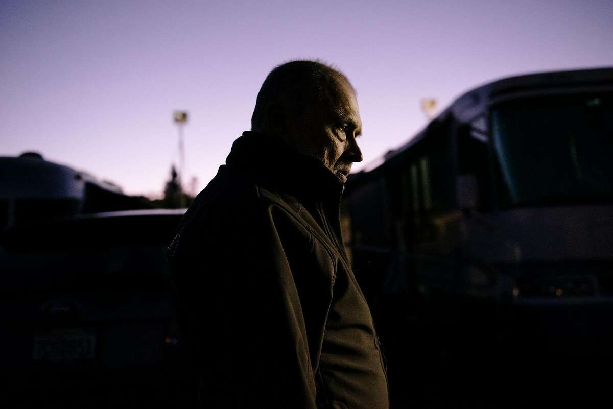 Bill Boutin walks through the Cloverdale Citrous Fairgrounds evacuation center in Cloverdale, California, on Wednesday, Oct. 30, 2019. Bill and Kaylynn lost their home to the Pocket Fire in Geyserville in 2017, and after living in their RV for the last few years, they recently had to evacuate under threat of the Kincade Fire