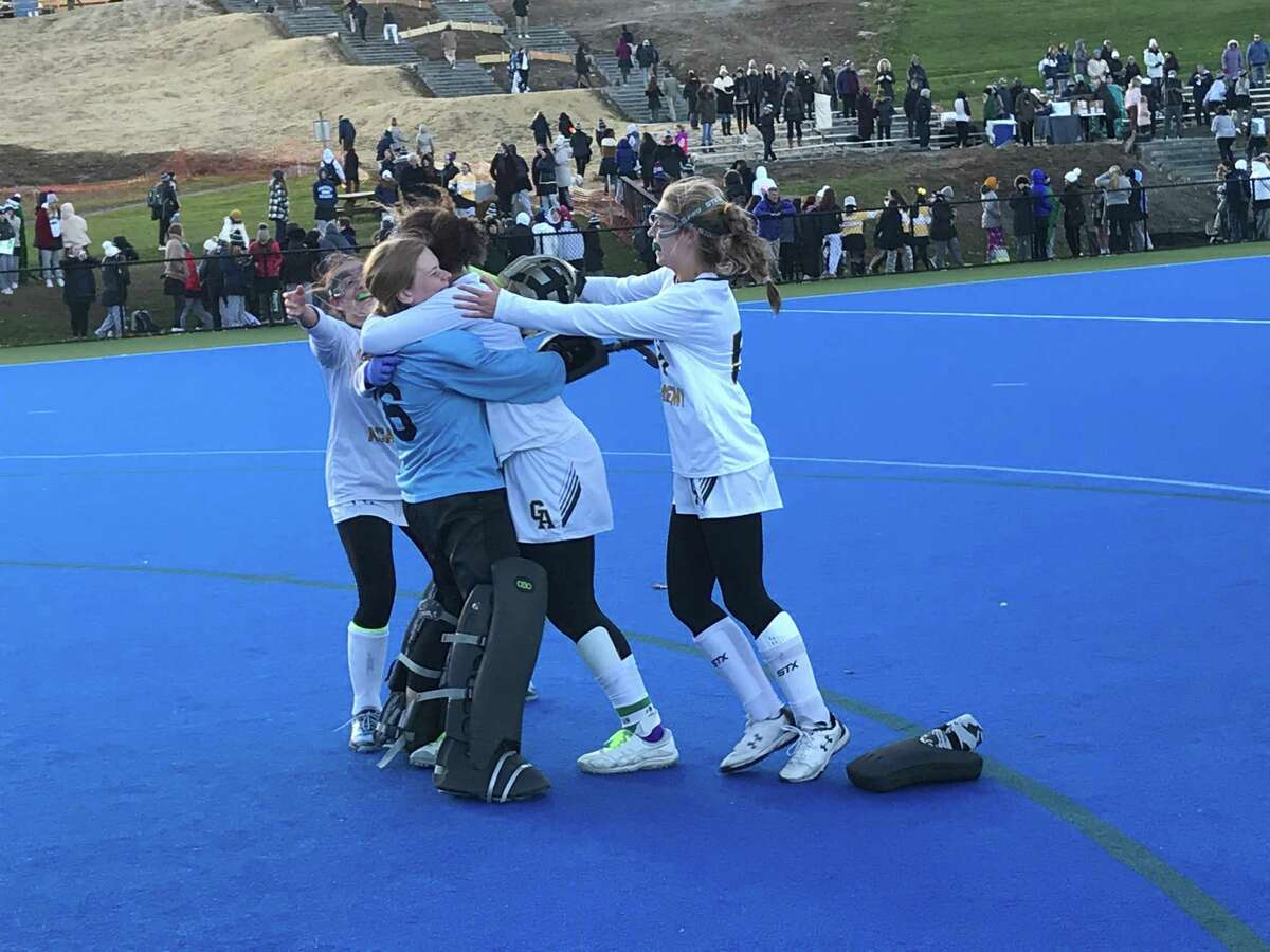 Greenwich Academy goalie Kathryn Gregory, left, embraces teammate Maya Walker following the Gators' 1-0 win over Sacred Heart Greenwich in the championship game of the FAA Tournament held at Sacred Heart Greenwich on Friday, November 8, 2019, in Greenwich. To the far right is Evelyn Barringer.