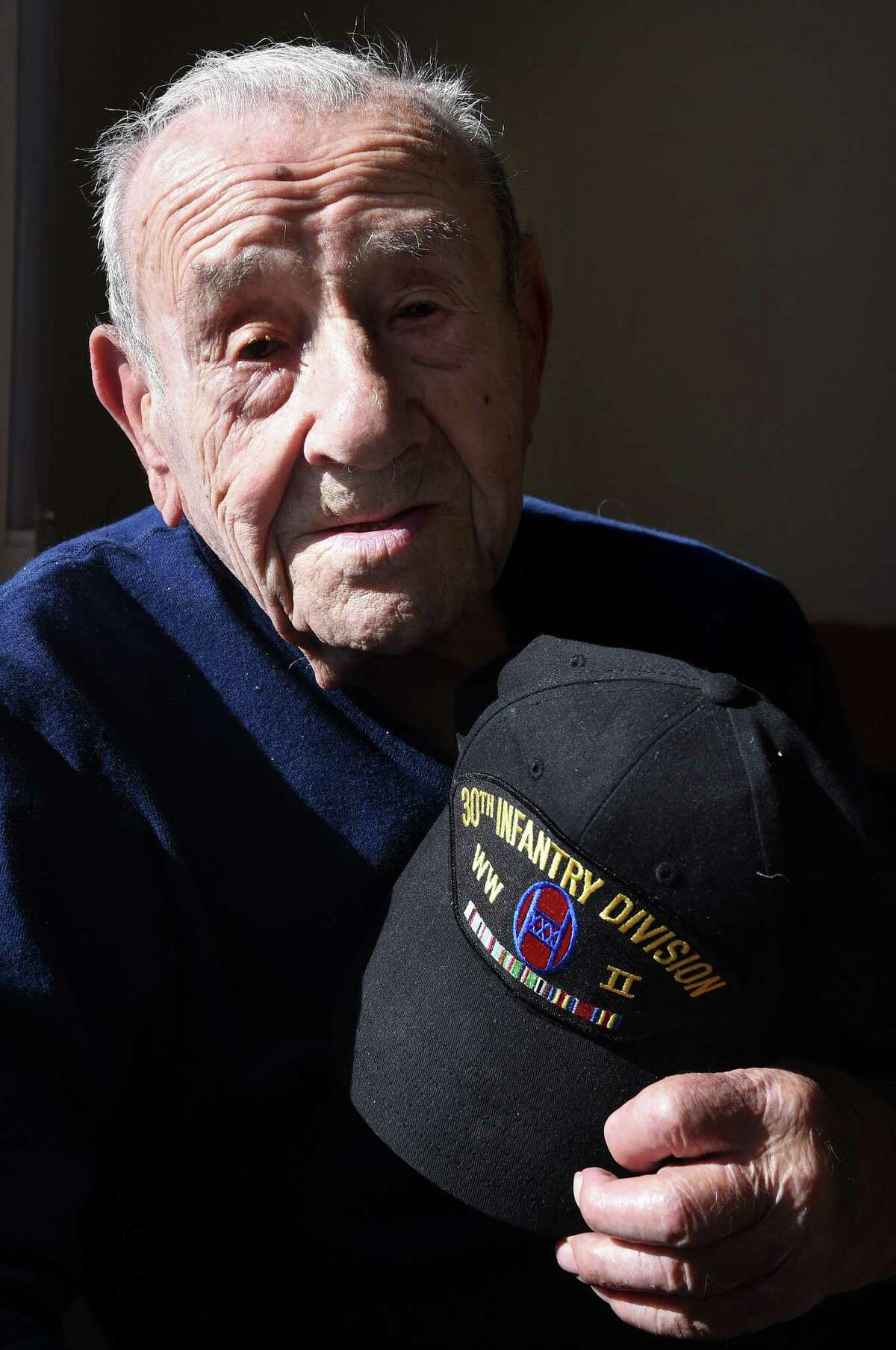 World War II Army veteran Albert Rapini, who took part in the invasion of Omaha Beach, is photographed at his home in Orange on November 8, 2019.