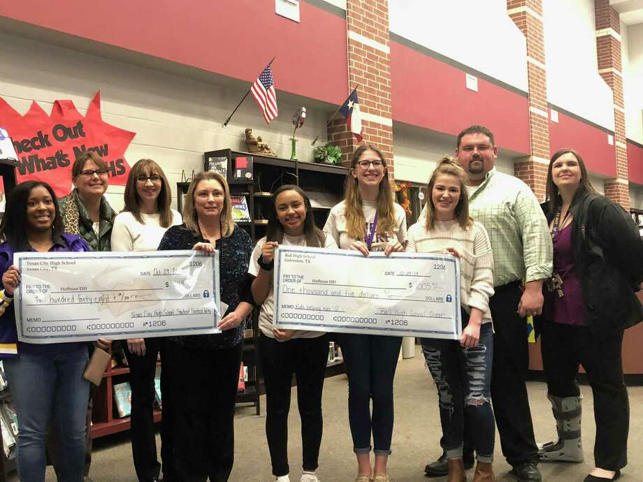 Representatives from Galveston Ball High School presented money they raised to help Huffman ISD students. Photo: Elliott Lapin / Staff Photo