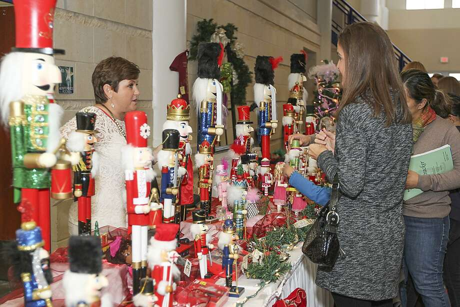 Melissa Maudlin (R) discusses nutcrackers with show vendor Dana Herzog (L) at the Cy Fair Mistletoe Gift Market held at the Berry Center on November 22, 2014. Photo: Diana L. Porter, Freelance / For The Chronicle / © Diana L. Porter