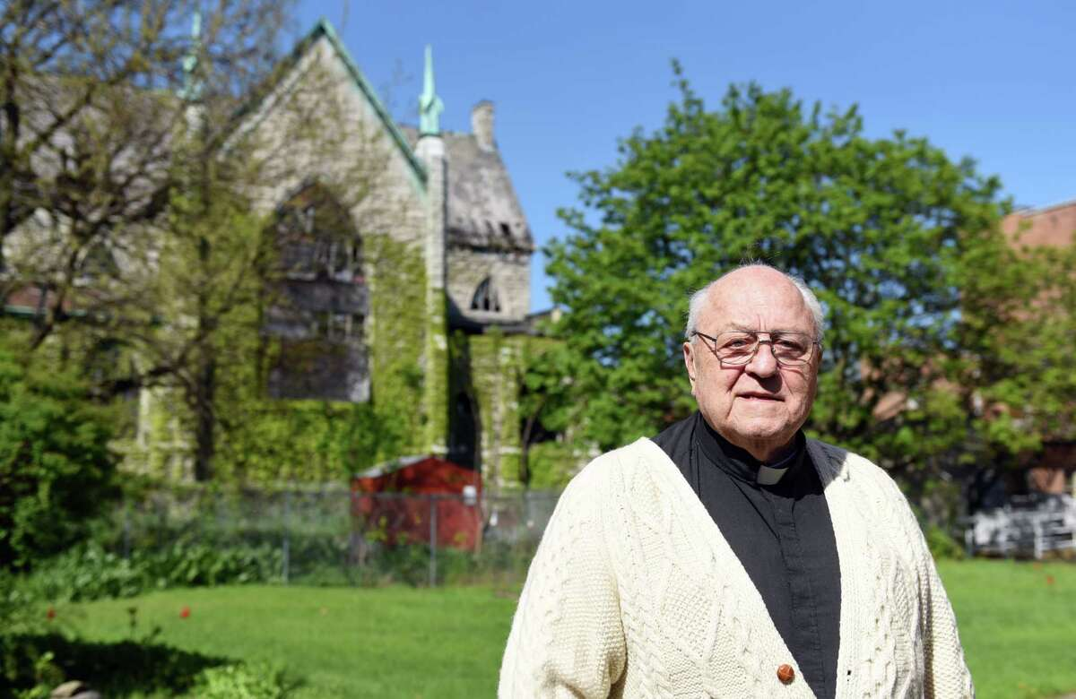 Father Peter Young stands in front of the former Saint John's Church where he used to be Pastor of 40 years ago on Wednesday, May 8, 2019 in Albany, NY. (Phoebe Sheehan/Times Union)