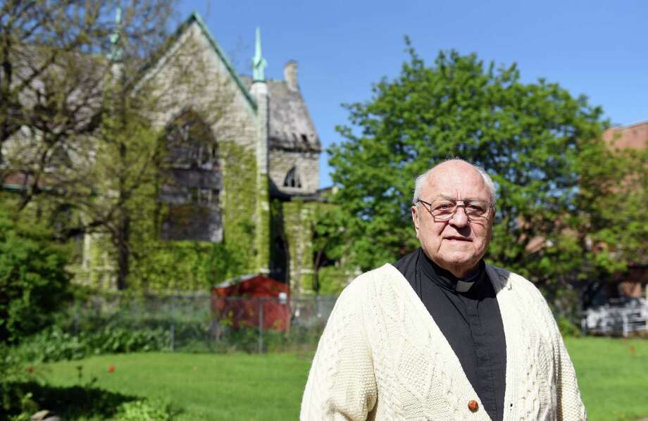 Father Peter Young stands in front of the former Saint John's Church where he used to be Pastor of 40 years ago on Wednesday, May 8, 2019 in Albany, NY. (Phoebe Sheehan/Times Union) Photo: Phoebe Sheehan / 20046883A