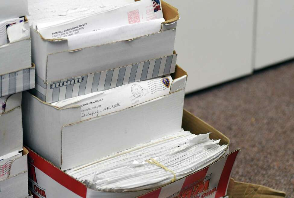 Father Peter Young has stacks of letters from convicts about to be released from prison in his office on Wednesday, May 8, 2019 in Albany, NY. (Phoebe Sheehan/Times Union)