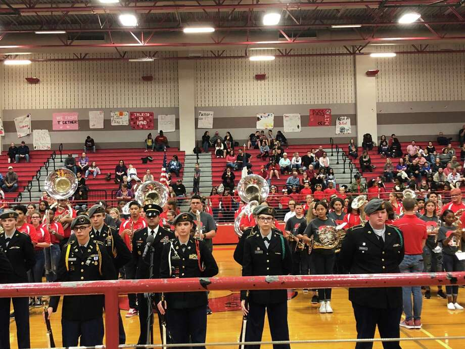 "All of the student groups that performed during the Crosby ISD Veteran's Celebration on Nov. 7, came together on the floor of the Crosby Middle School gym for the finale, a rendition of ""America the Beautiful"" Photo: Elliott Lapin / Staff Photo"