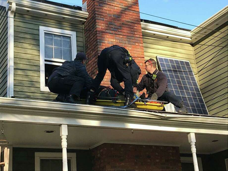 The Fairfield FD helped a worker injured while working on an Elm Street home in Fairfield, Conn., on Friday, Nov. 8, 2019. Photo: Contributed Photo / Fairfield Fire Department