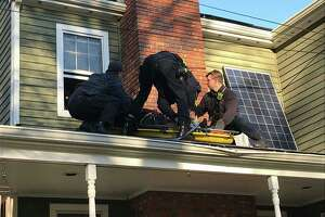 The Fairfield FD helped a worker injured while working on an Elm Street home in Fairfield, Conn., on Friday, Nov. 8, 2019.