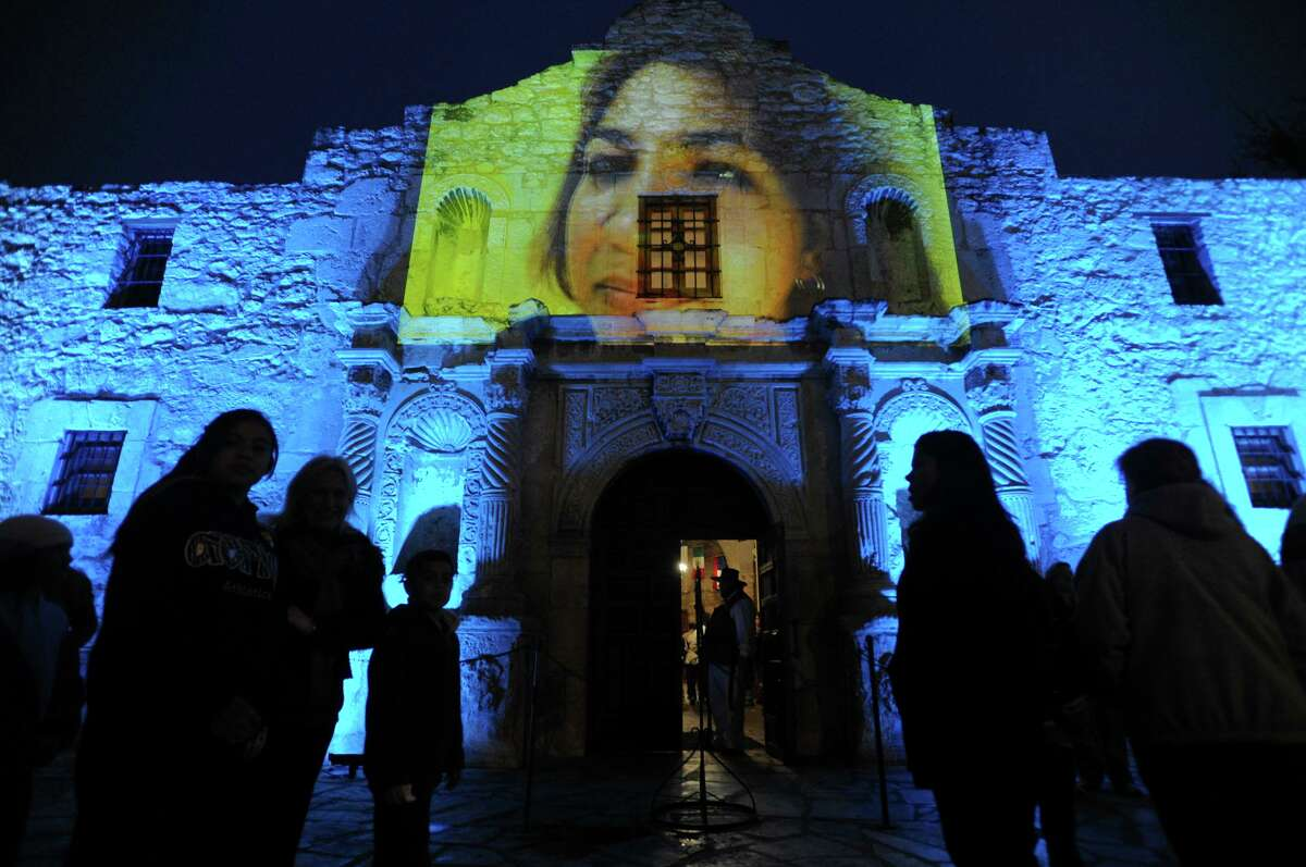 """A video showing indigenous and mestizo people of Texas is projected on the Alamo shrine during """"Luminaria: Arts Night in San Antoinio,"""" on Saturday, March 14, 2009. The video was part of a artistic piece entitled """"Enlight Tent"""" by Vaago Weiland and Laura Varela BILLY CALZADA / gcalzada@express-news.net"""