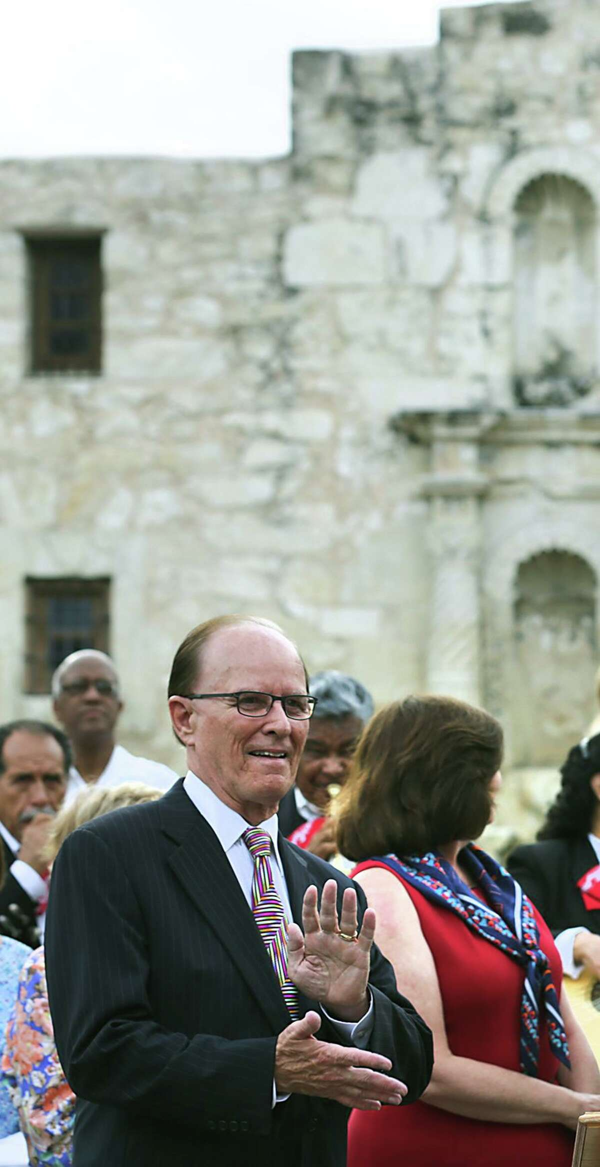 City leaders including Bexar County Nelson Wolff, left, and Mayor Ivy Taylor, center, celebrate the announcement of the San Antonio's Spanish missions winning World Heritage Site status on Tuesday, July 7, 2015 in front of The Alamo.